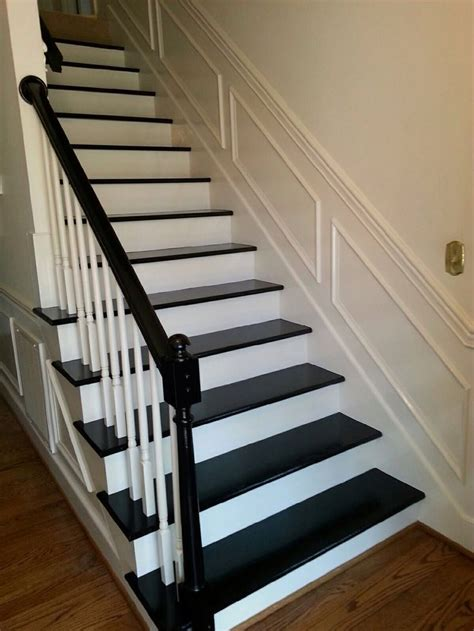 Black painted staircase and arm rail after carpet removed